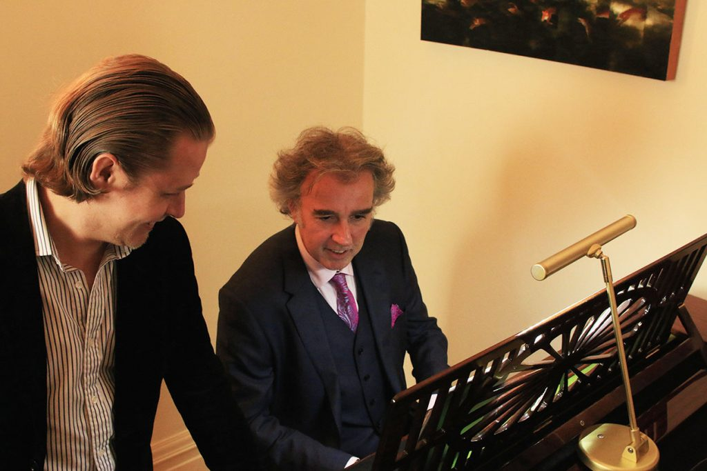 Stefan Joubert teaching piano to Tim at the London Piano Institute